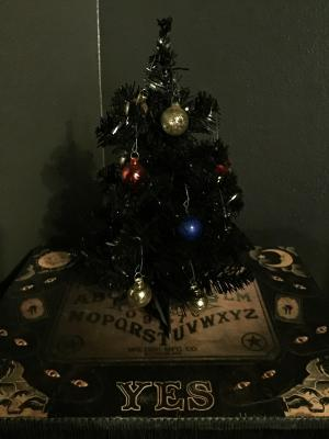 little black gothic christmas tree with vintage glass ornaments